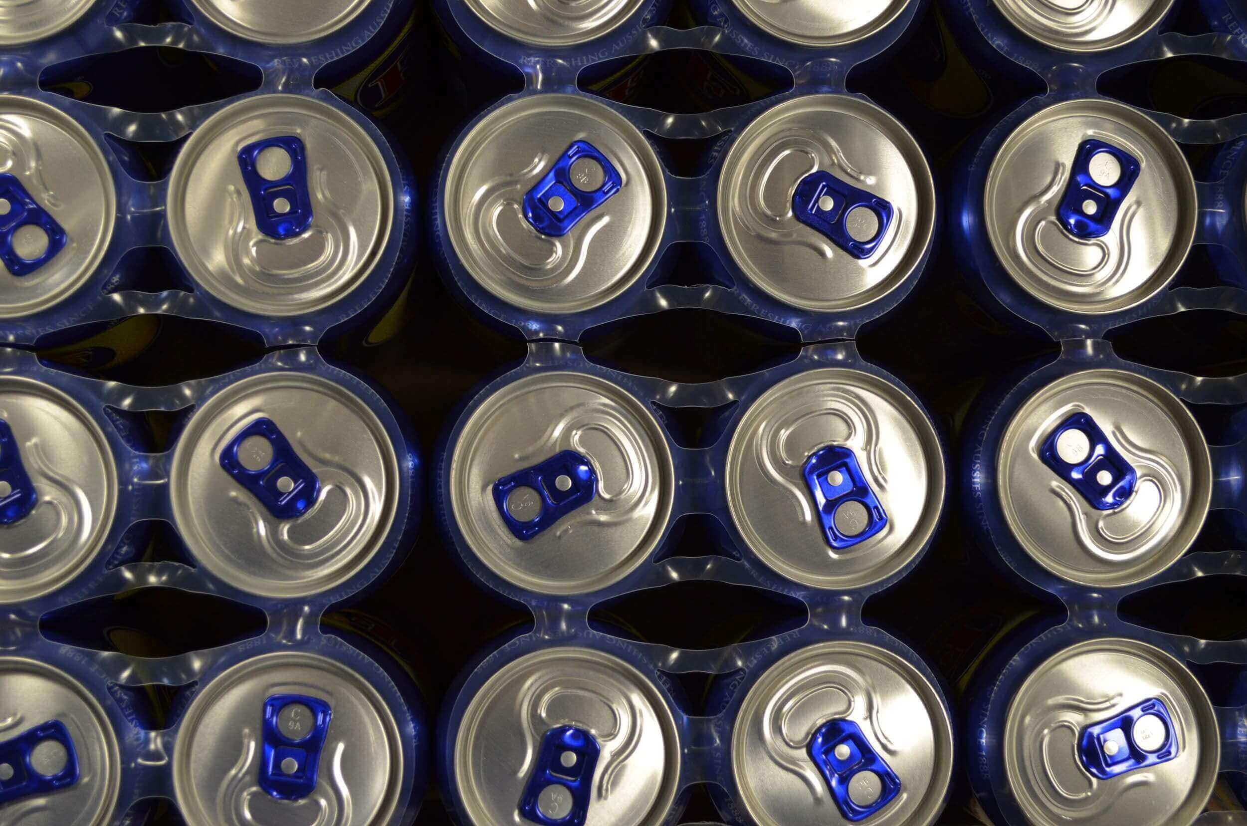 Blue soda cans with blue tabs from a top down view